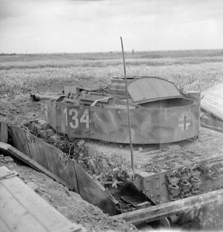 A knocked-out German PzKpfw IV tank in a hull-down position, 13 July 1944.