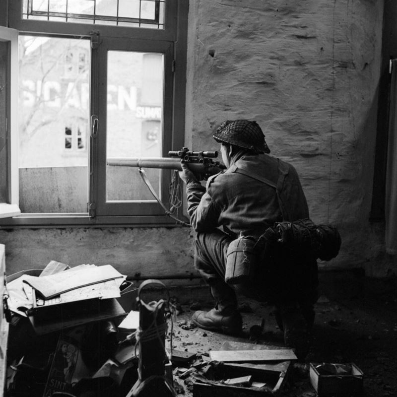 A sniper from C Company, 5th Battalion, The Black Watch , 51st (Highland) Division, in position in a ruined building in Gennep, Holland, 14 February 1945.