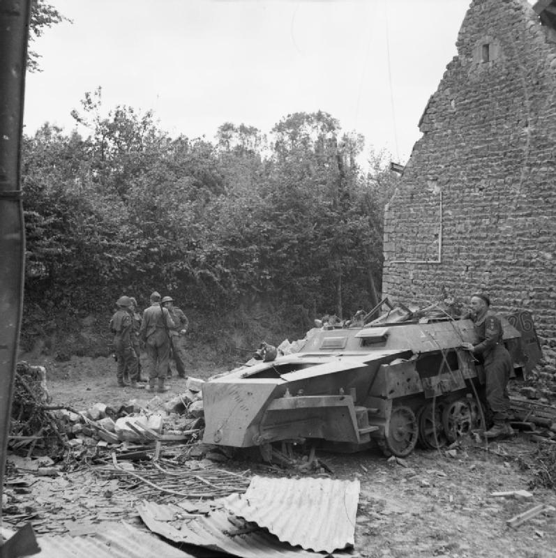 A wrecked German SdKfz 250 half-track in the village of Christot, 17 June 1944.