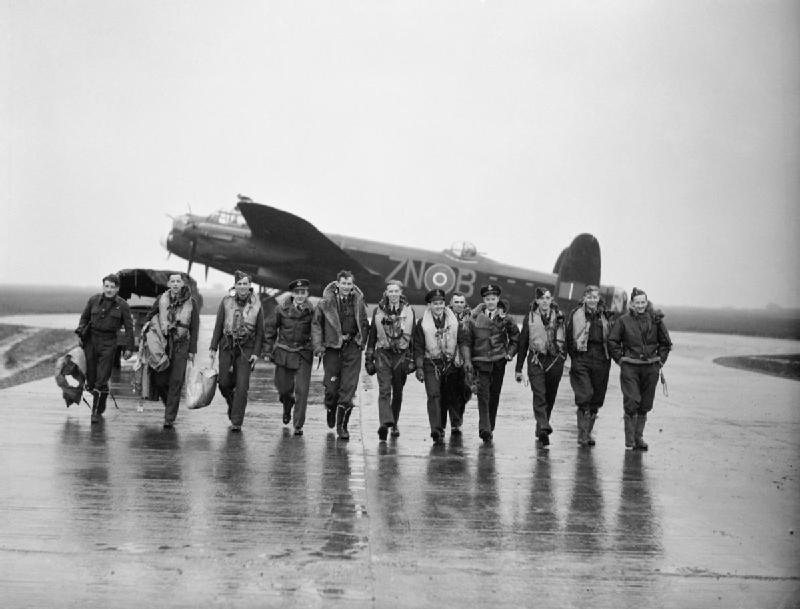 Aircrew of No. 106 Squadron photographed in front of a Lancaster at Syerston, Nottinghamshire, on the morning after the raids on Genoa, 22-23 October 1942. Crews of No 106 Squadron photographed in front of a Lancaster at Syerston, Nottinghamshire, on the morning after the raids on Genoa, 22-23 October 1942. Fourth from the right is Pilot Officer David Shannon, a future 'Dambuster' and leading light of No 617 Squadron.