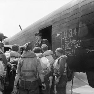 British former prisoners of war prepare to board an Avro Lancaster B Mark I, PB934, of No. 582 Squadron RAF at Lubeck, Germany, for repatriation to the United Kingdom.