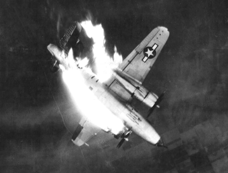 A U.S. Army Air Forces Martin B-26G-11-MA Marauder (s/n 43-34565) from the 497th Bombardment Squadron, 344th Bombardment Group, 9th Air Force, enveloped in flames and hurtling earthward after enemy flak scored a direct hit on left engine while aircraft was attacking front line enemy communications center at Erkelenz, Germany
