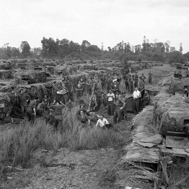 Churchill tank crews of 31st Tank Brigade with their extensively camouflaged vehicles, 13 July 1944.