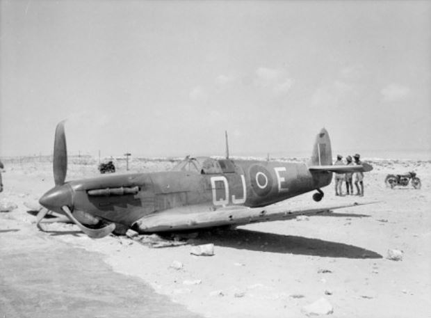A Supermarine Spitfire Mk.Vb from No. 92 Squadron (QJ-E), Royal Air Force, which made a forced landing near El Alamein, just off the main Alexandria-Mersa Matruh road.