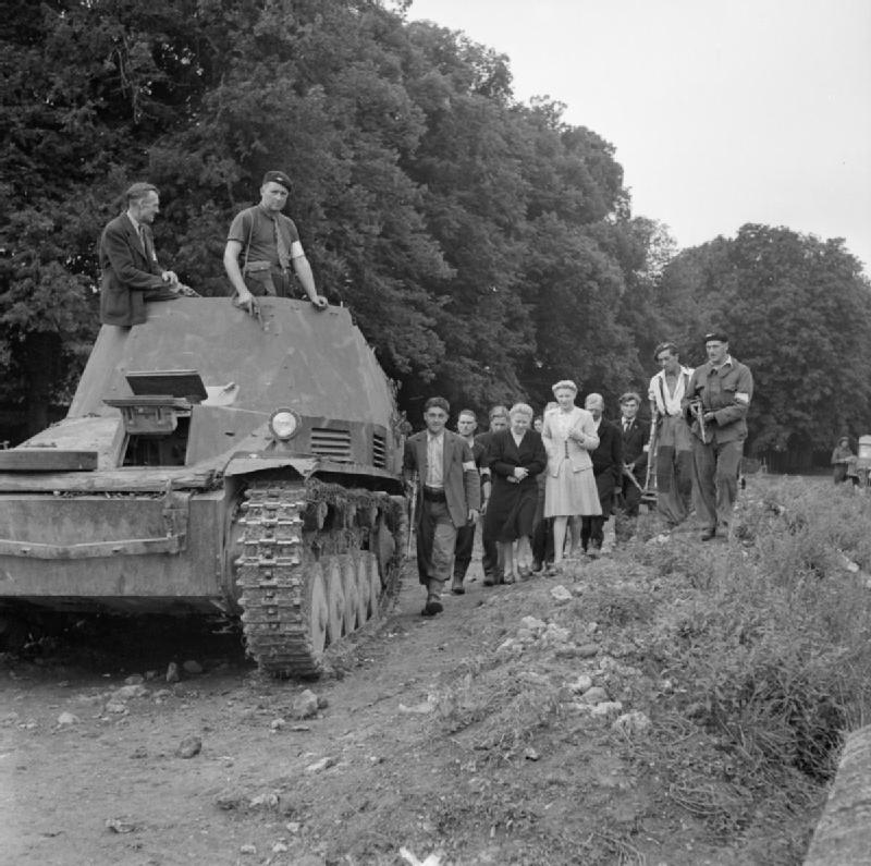 FFI and French civilians with a captured German Wespe ammunition carrier, 30 August 1944.
