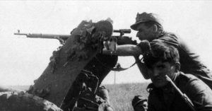 German soldier with his captured Soviet Mosin Nagant PEM sniper rifle