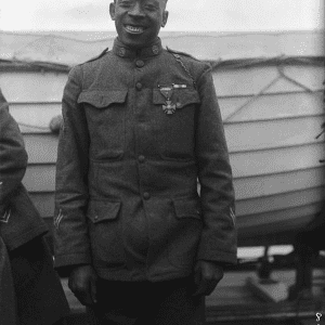 """Sergeant Henry Lincoln Johnson, 369th Infantry (""""Harlem Hellfighters""""), who single-handedly fought off a german raiding party to save his comrade, Private Needham Roberts, 1918."""