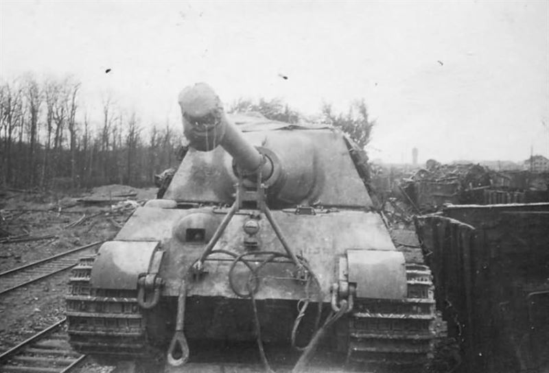 Jagdtiger of Schwere Panzerjager Abteilung 653 Steinweiler Pfalz 1945. Tank destroyer being transported on rail car.