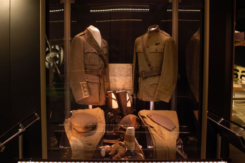 (Left) British Royal Flying Corp cap, tunic, trousers and flying equipment worn by Capt. William C. Lambert during World War I. The bar decoration below the RFC wings on the tunic was the ribbon design for the original British Distinguished Flying Cross. (Right) Uniform items worn by Lt. Stephen W. Thompson on Feb. 5, 1918, when, while flying as an observer with the French, he became the first person in U.S. uniform to down an enemy airplane. (U.S. Air Force photo)