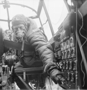 Flying Officer J B Burnside, the flight engineer on board an Avro Lancaster B Mark III of No. 619 Squadron RAF based at Coningsby, Lincolnshire, checks settings on the control panel from his seat in the cockpit.