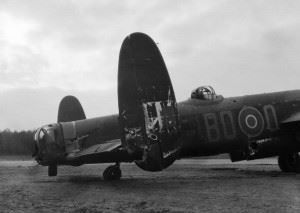 The rear section of Avro Lancaster B Mark I, DV305 'BQ-O', No. 550 Squadron RAF based at North Killingholme, Lincolnshire, seen at Woodbridge Emergency Landing Ground, Suffolk, after the severely-damaged aircraft crash-landed there following an attack by a German night fighter over Berlin on the night of 30/31 January 1944. In the course of the attack both the rear gunner and the mid-upper gunner were killed, and the bomb-aimer baled out having misunderstood orders. The pilot, Flying Officer G A Morrison, managed to bring the crippled aircraft back without any navigation aids.