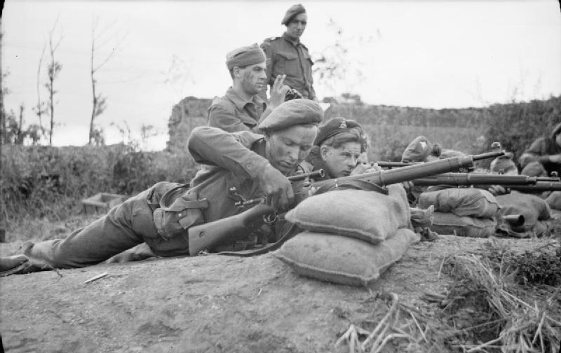 Snipers training at a sniper school in a French village, 27 July 1944.