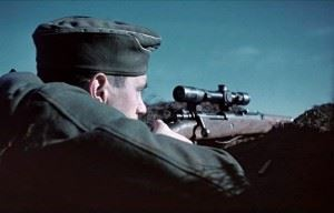 Soviet union, before Stalingrad. Photo shows German sniper using the Mauser 98k rifle with Russian PE scope mounted.