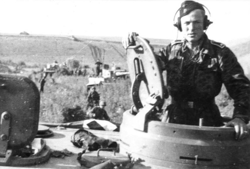 "A soldier of the SS-Panzer-Division ""Das Reich"" stands in his Tiger's turret during the Battle for Kursk."