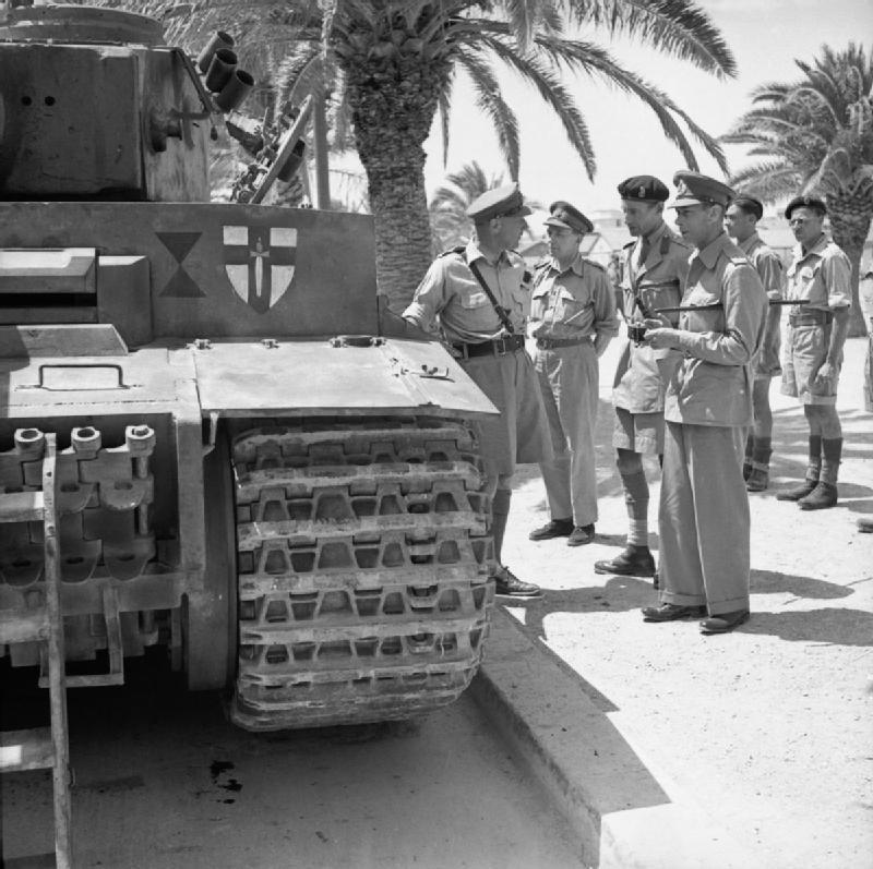 The British Army in Tunisia 1943 The King inspects a captured German Tiger I tank in Tunis, June 1943.