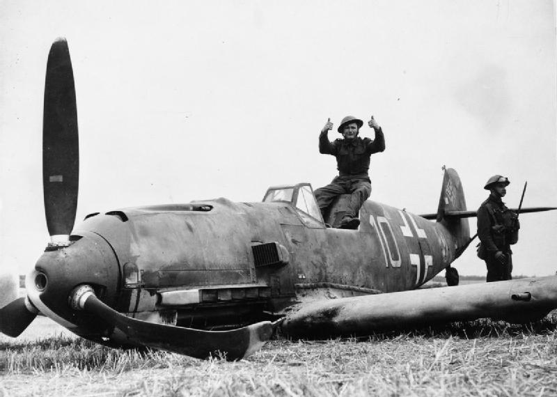 Soldiers pose with Messerschmitt Bf 109E-4 (W.Nr. 5587) 'Yellow 10' of 6./JG 51 'Molders', which crash-landed at East Langdon in Kent, 24 August 1940. The pilot, Oberfeldwebel Beeck, was captured unhurt.