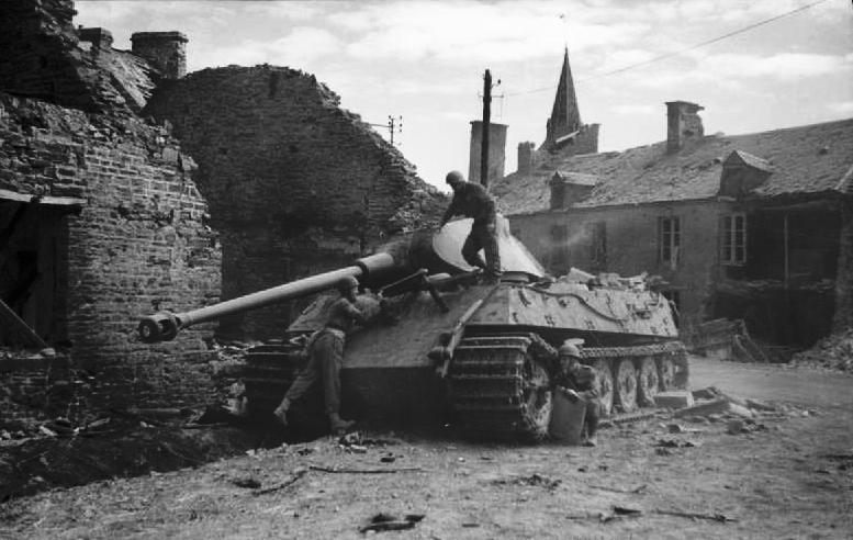 Troops inspect a knocked out King Tiger tank in Le Plessis-Grimoult, 10 August 1944.