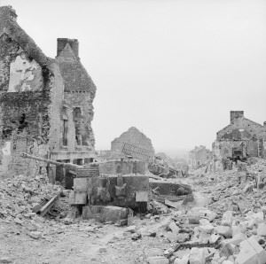 Wrecked German Tiger tanks in the rubble of Villers Bocage after the British had captured the town, 5 August 1944.