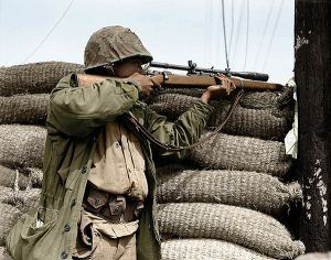 Marine Sniper with a Springfield 1903A1 and Unertl 8-power scope. Note the length and size of the objective lens.