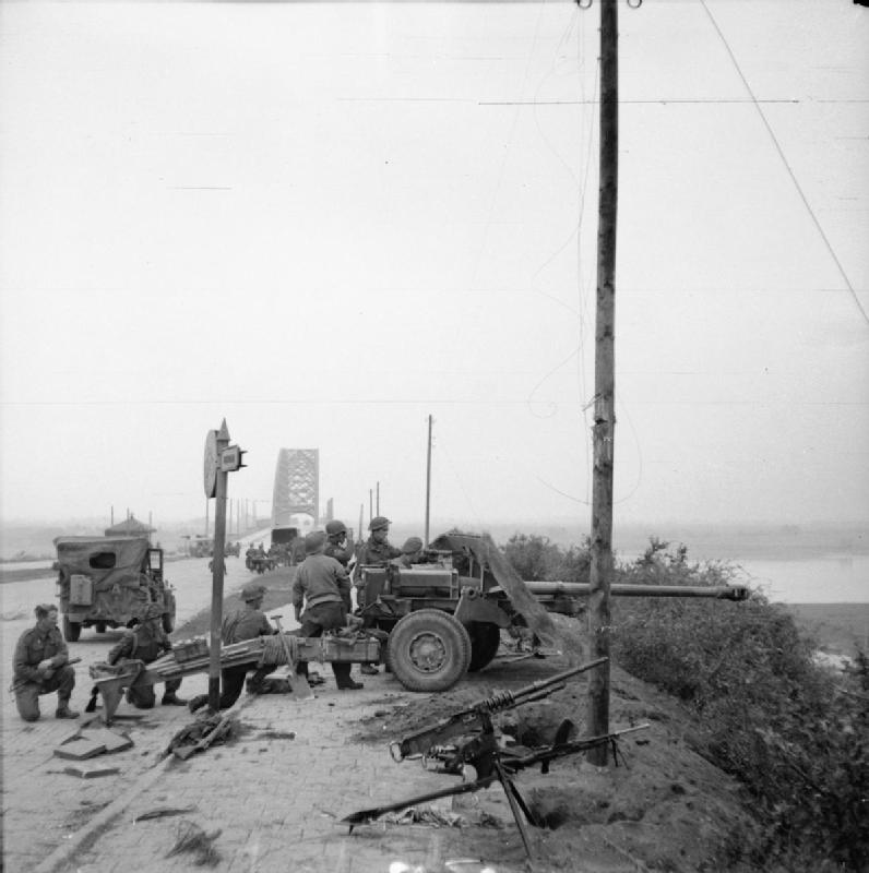 17-pdr anti-tank gun of the 21st Anti-Tank Regiment, Guards Armoured Division, guards the approaches to Nijmegen Bridge.