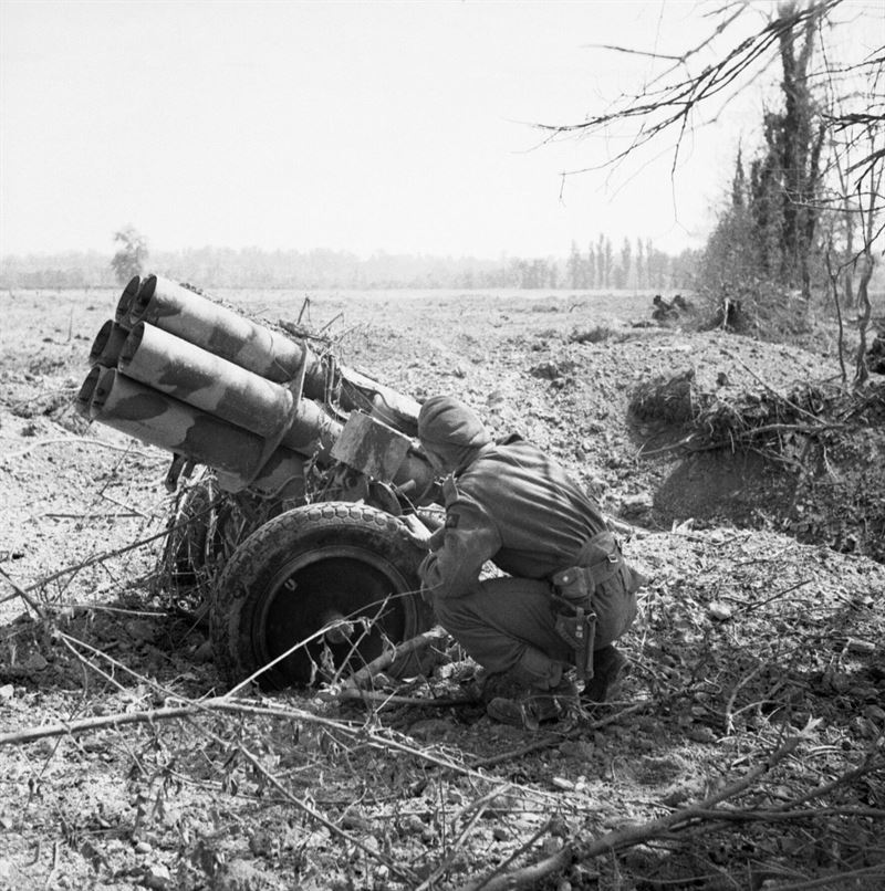 A British soldier examines an abandoned German 'Nebelwerfer' near Troarn, Normandy, 20 July 1944.