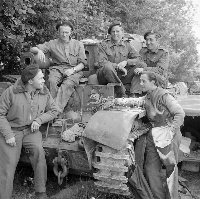 Captain L Cotton MM with his Cromwell VI tank, 'Old Bill', and crew of 4th County of London Yeomanry, 7th Armoured Division, 17 June 1944. Cotton had been promoted to captain following the regiment's action at Villers Bocage.