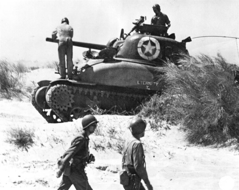 Crew from the tank Eternity check their vehicle after landing at Red Beach 2, Sicily.