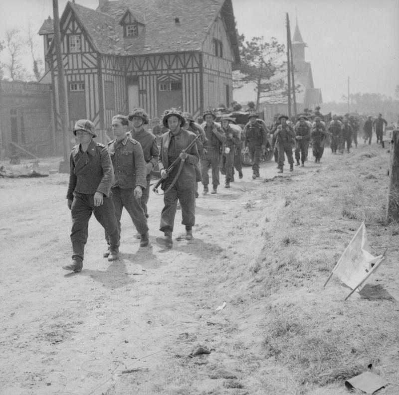 German prisoners being escorted back through La Brèche d'Hermanville by men of the 2nd King's Shropshire Light Infantry, 6 June 1944.