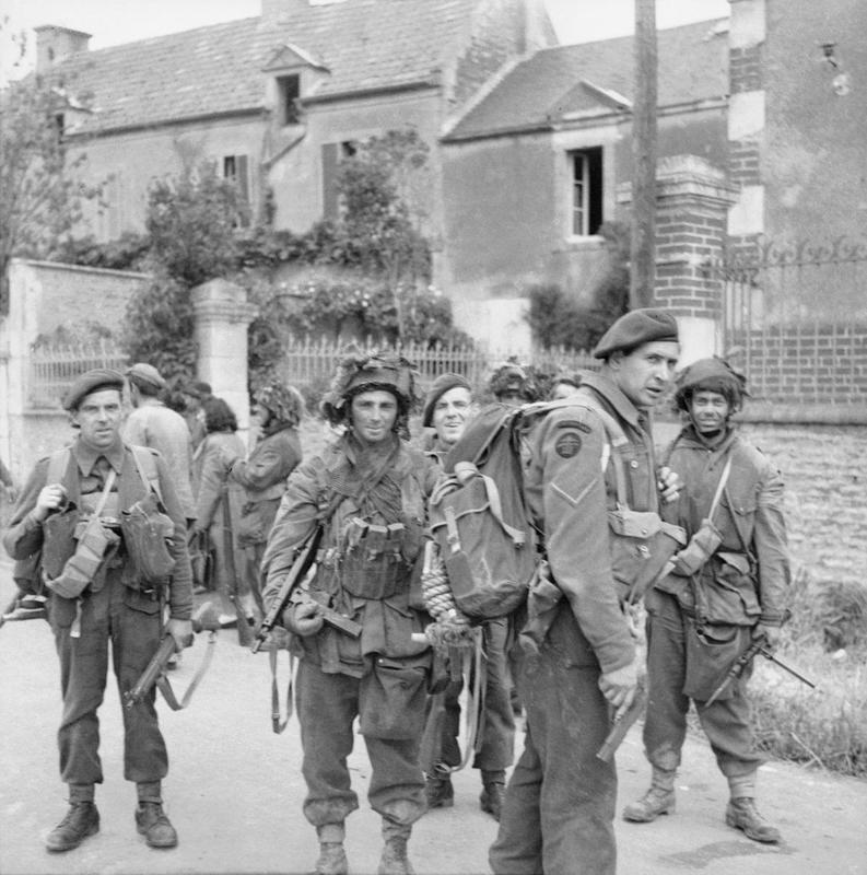 Commandos of No. 4 Commando, 1st Special Service Brigade, and troops of 6th Airborne Division in Bénouville after the link-up between the two forces, 6 June 1944.