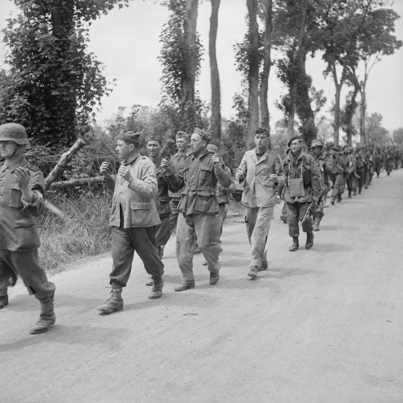 Commandos of 1st Special Service Brigade march German and Italian prisoners back to the rear, 6 June 1944.