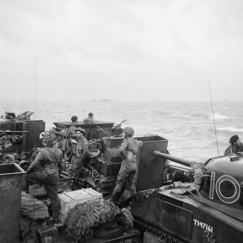 Sherman tanks and other vehicles of 13th/18th Royal Hussars, 27th Armoured Brigade, aboard LCT 610 approaching the French coast, 6 June 1944.