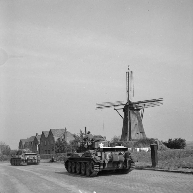 Cromwell tanks of Guard's Armoured Division drive along 'Hell's Highway' towards Nijmegen during Operation 'Market-Garden', 20 September 1944
