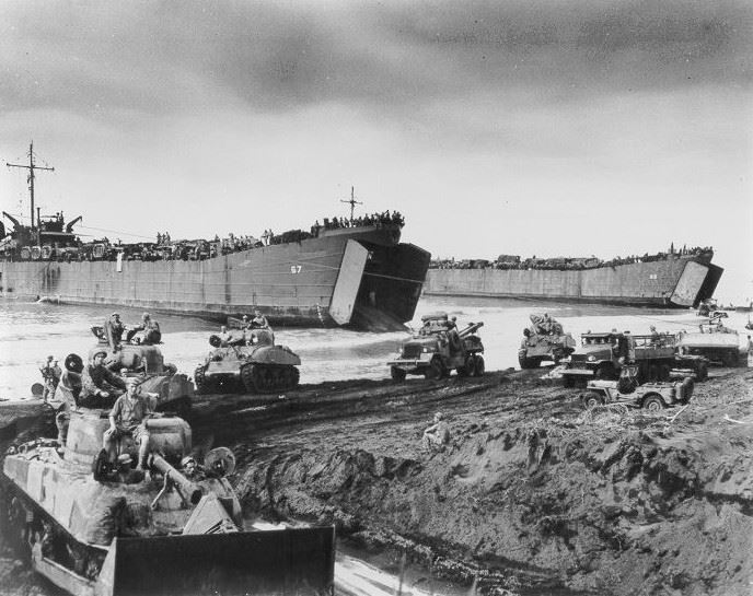 LST-66 (far right) and LST-67 disembark M4 Sherman tanks and other vehicles during the Western New Guinea operation, Invasion of Noemfoor Island in July 1944.
