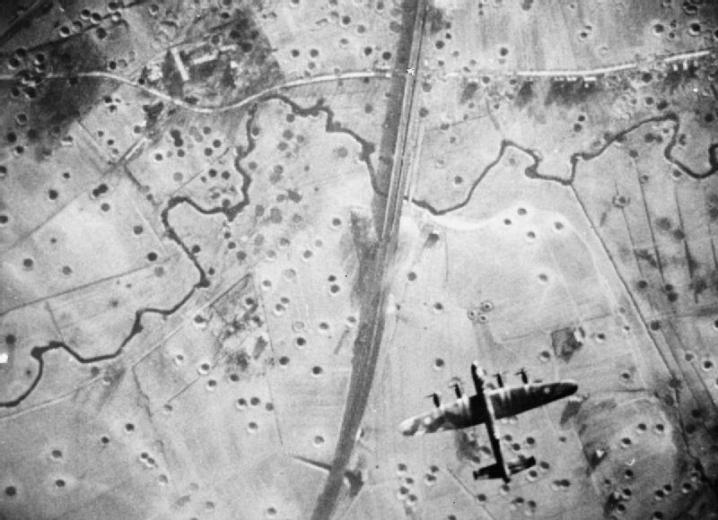 Avro Lancaster of No. 617 Squadron RAF flying over the target during a daylight raid on the railway viaduct at Schildesche, Bielefeld, Germany
