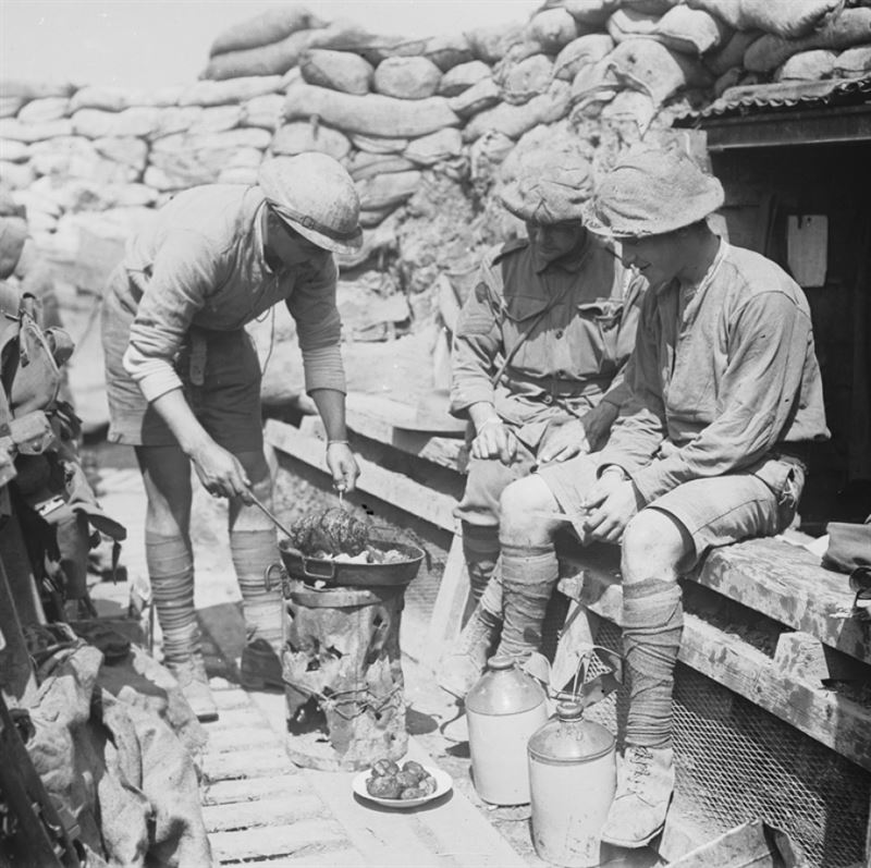 Men of the 2nd Australian Division in a front-line trench near Armentières cooking a meal.