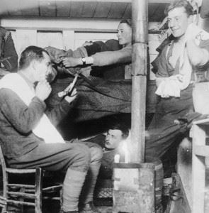 Officers of the East Yorkshire Regiment wash, shave and dress in their dugout.