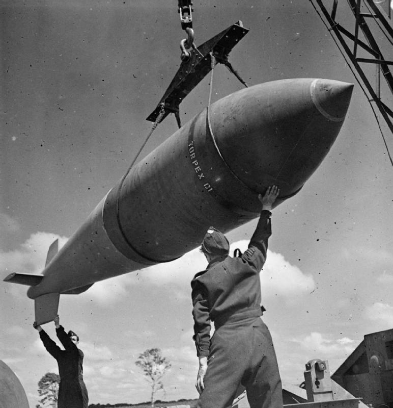 A 12,000-lb MC deep-penetration bomb (Bomber Command executive codeword 'Tallboy') is hoisted from the bomb dump to its carrier at Woodhall Spa, Lincolnshire, to be loaded into an Avro Lancaster of No. 617 Squadron RAF for a raid on the V-weapon site at Wizernes, France. 617 Squadron were unable to bomb the target on this occasion because of low cloud cover, but were to succeed two days later.