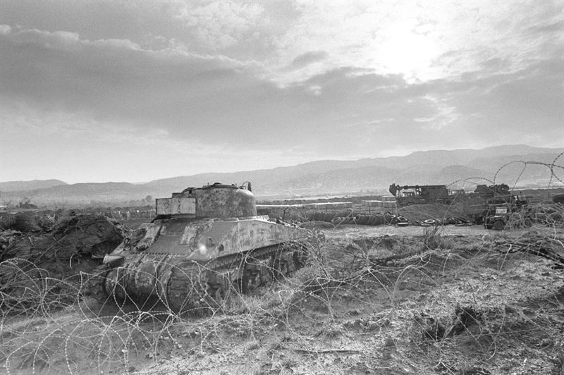 A left front view of a wrecked and stripped Israeli Sherman Firefly tank, as the 22nd Marine Amphibious Unit redeploys back to ships of Amphibious Squadron 4