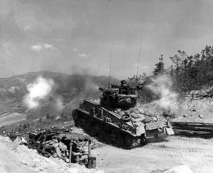 "M4A3E8 ""Sherman"" Tank of Company B, 72nd Tank Battalion, 2nd Infantry Division, fires its 76mm gun at enemy bunkers on ""Napalm Ridge"", in support of the 8th ROK Division."