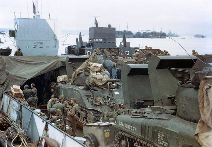 "U.S. Army M4 ""Sherman"" tanks of Company A, 741st Tank Battalion and other equipment loaded in an LCT, ready for the invasion of France, circa late May or early June 1944."