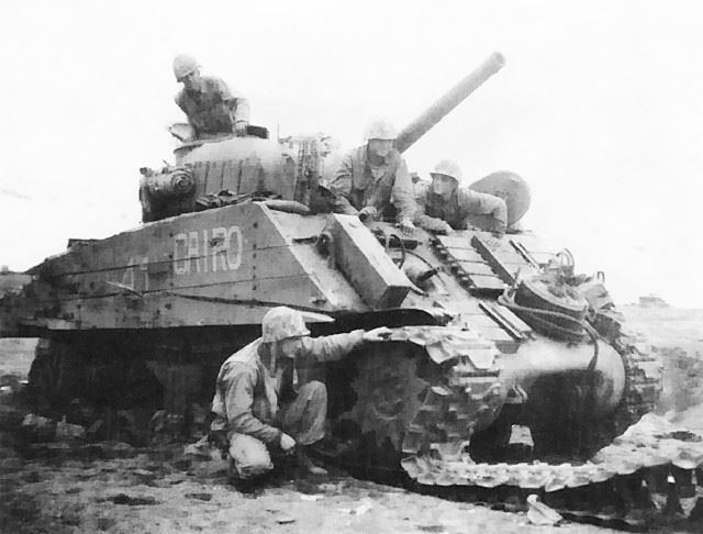 This Sherman Tank was disabled by a land mine and five hits by Japanese artillery at Iwo Jima, but the crew escaped uninjured.