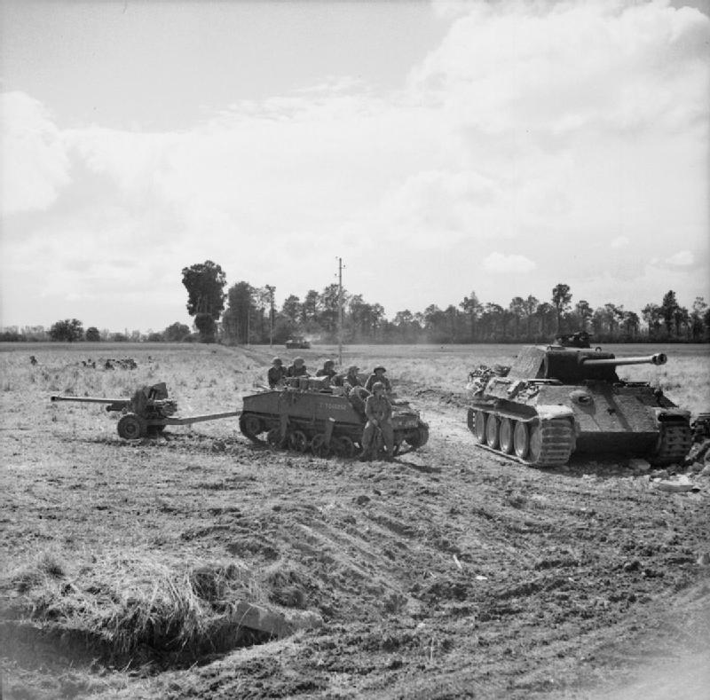 A Loyd carrier and 6-pdr anti-tank gun of the Durham Light Infantry, 49th (West Riding) Division parked alongside a knocked-out German Panther tank during Operation 'Epsom', 27 June 1944.