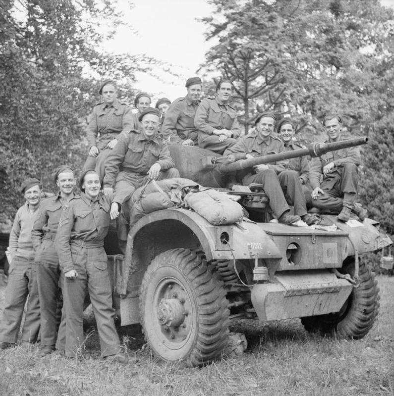 Daimler armoured car and crews of 1st Troop, 'C' Squadron, 11th Hussars, 22 September 1944.