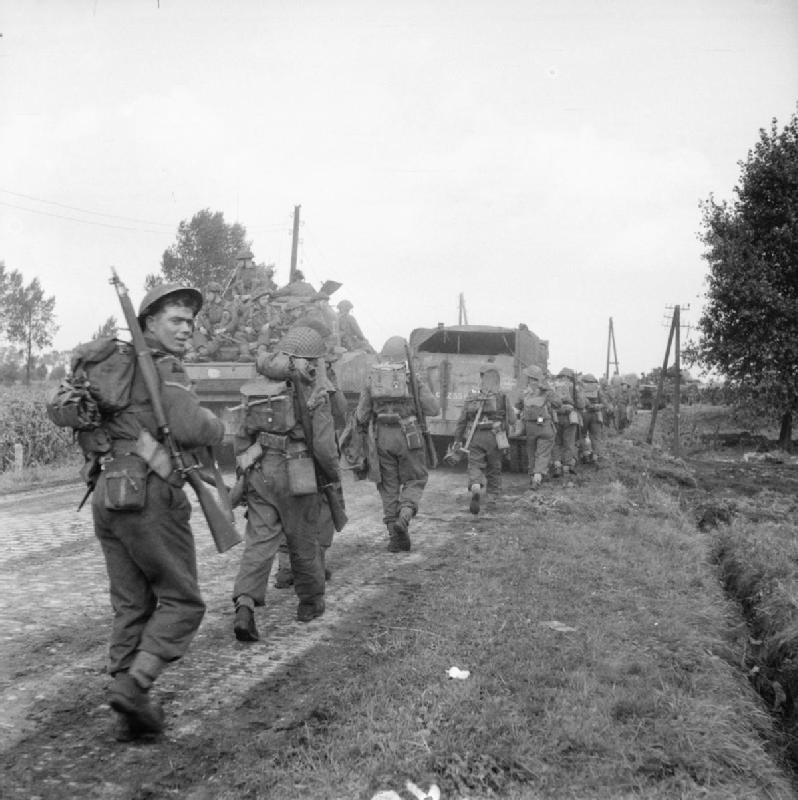 Tanks and infantry approaching Asten in Holland, 24 September 1944.