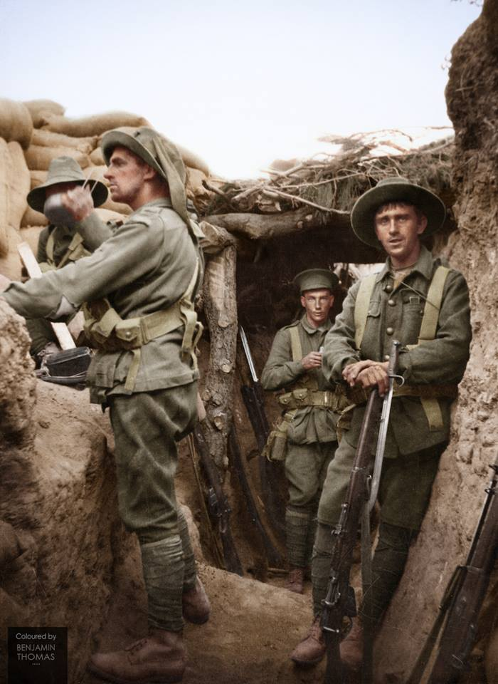 Exhausted Australian soldiers pose for a candid photograph in the captured Turkish trenches at Lone Pine, Gallipoli Peninsula, on the afternoon of the 6 August 1915.