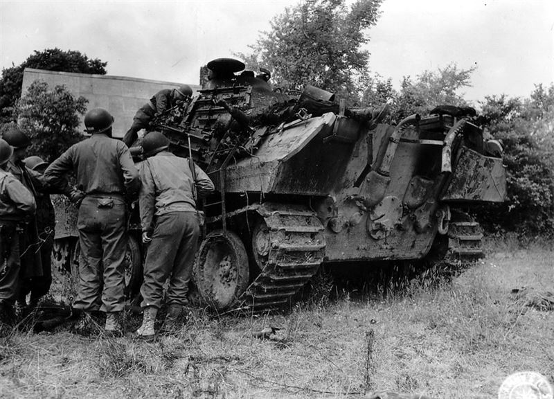 Panther wreck being inspected by U.S. Soldiers in Normandy.
