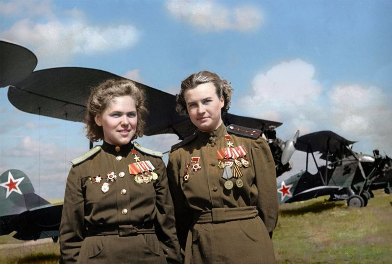 Soviet Air Force officers, Rufina Gasheva (848 night combat missions) and Nataly Meklin (980 night combat missions) decorated as 'Heroes of the Soviet Union' for their service with the famed 'Night Witches' unit during World War II They stand in front of their Polikarpov Po-2 biplanes.