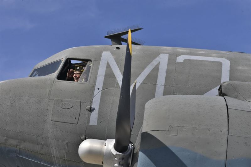 Retired Lt. Col. Alston Daniels salutes out of the window of a Douglas C-47D Skytrain on static display at Fairchild Air Force Base, Wash., April 7, 2015. Daniels flew the C-47 during World War II and logged nearly 2,000 hours in the aircraft. (Credit: U.S. Air Force photo/ Staff Sgt. Alex Montes)