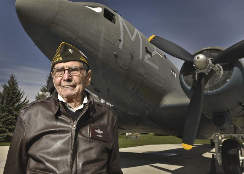Retired Lt. Col. Alston Daniels stands proudly outside of a Douglas C-47D Skytrain on static display at Fairchild AFB, Wash. April 7, 2015. Daniels flew the C-47 during World War II and calls it his favorite plane of the 10 he flew throughout his career. (Credit: U.S. Air Force/ Staff Sgt. Alex Montes)