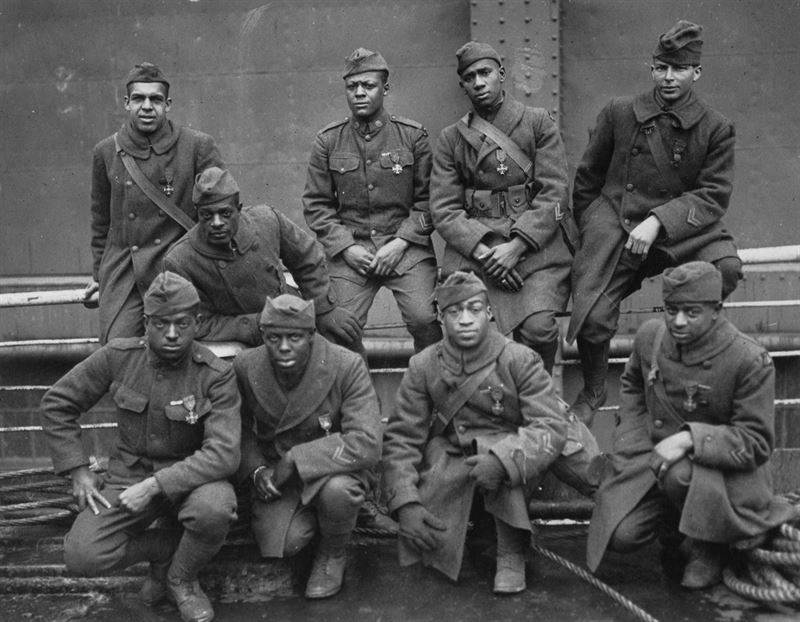 """Some of the colored men of the 369th (15th N.Y.) who won the Croix de Guerre for gallantry in action."" Left to right. Front row: Pvt. Ed Williams, Herbert Taylor, Pvt. Leon Fraitor, Pvt. Ralph Hawkins. Back Row: Sgt. H. D. Prinas, Sgt. Dan Strorms, Pvt. Joe Williams, Pvt. Alfred Hanley, and Cpl. T. W. Taylor. 1998 print. Records of the War Department General and Special. Staffs."